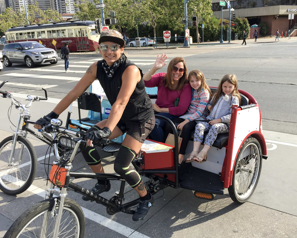 Jen Leo and Cora Riding a Pedicab