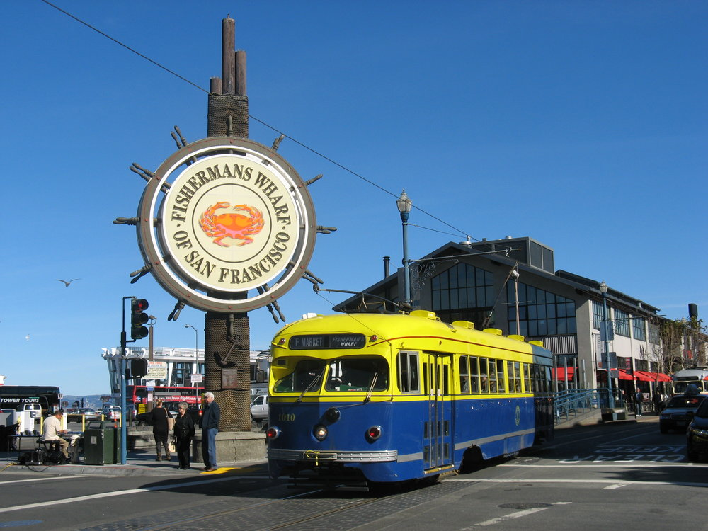 Fisherman's Wharf - Crab Wheel Sign and Street Car.jpg