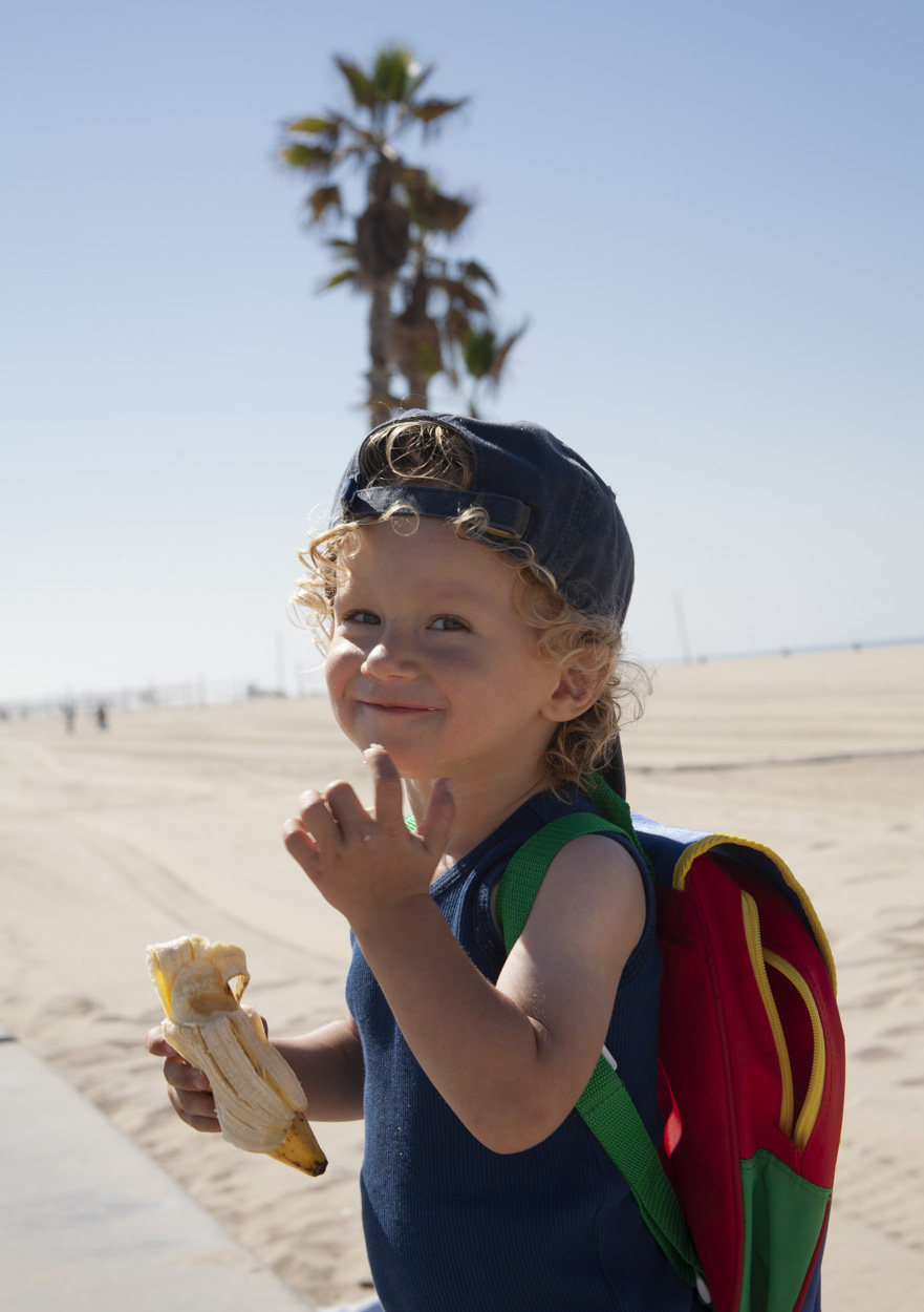 """I had taken my son down to the beach to take some pictures but he cried the whole time and just had a miserable time (and so did I) until we finished and I gave him this banana. His impish smile really represents his personality so well, and his expression always says to me """"so hey dad, how was   your   day, heh, heh?"""""""
