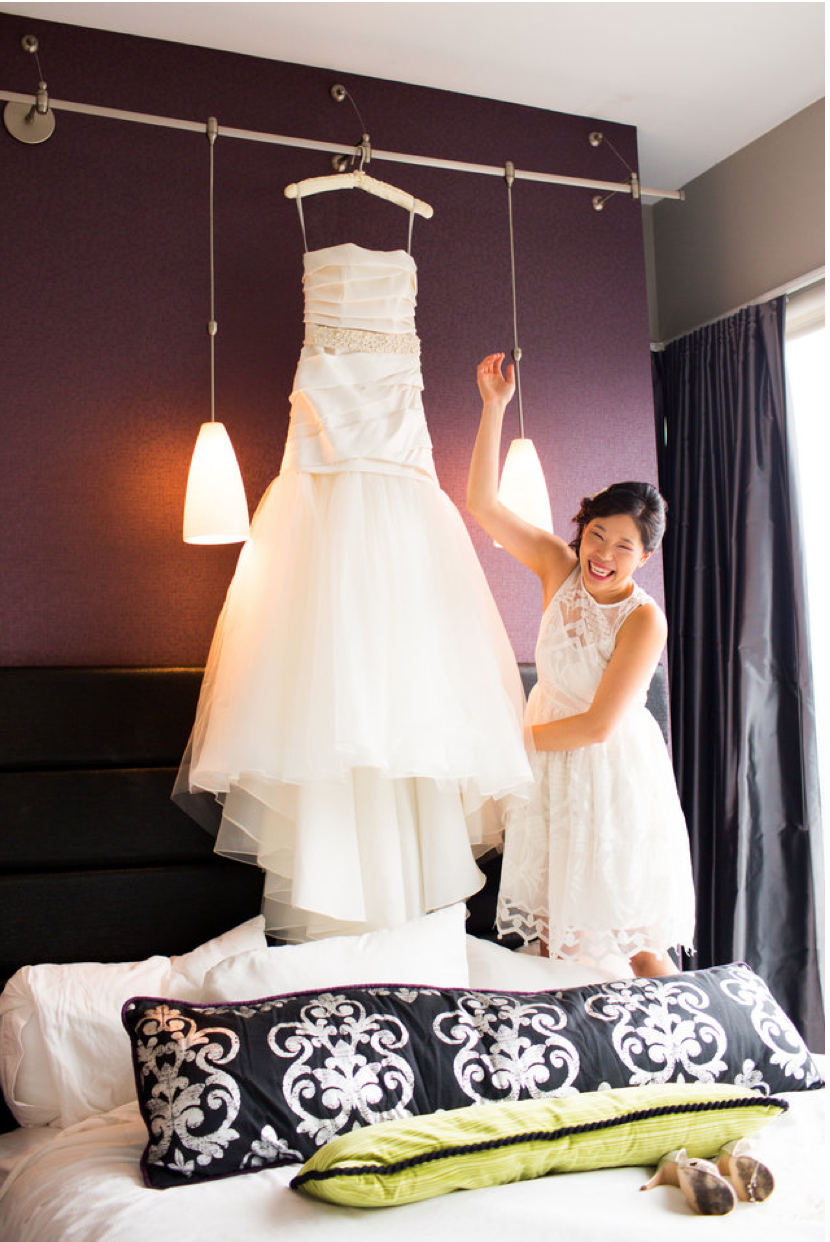 When the photographer dares the bride to jump on the bed to grab her Vera Wang dress.  I just loved my pineapple white dress from Anthropologie too!