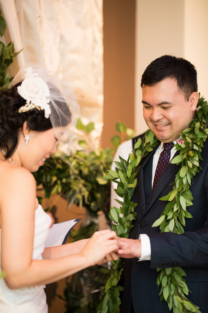 Custom wedding vows and ceremony.  Just loved the bay leaf lei on my husband and my special bird-cage veil designed by my friend, Salimi Akill.