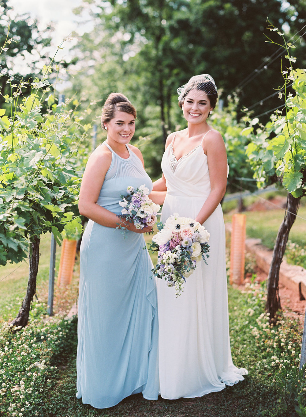 Jessica, the bride, with maid of honor, Heather. I just love this portrait of these sweet sisters/twins!   Cottrell Photography  |  Wolf Mountain Vineyards
