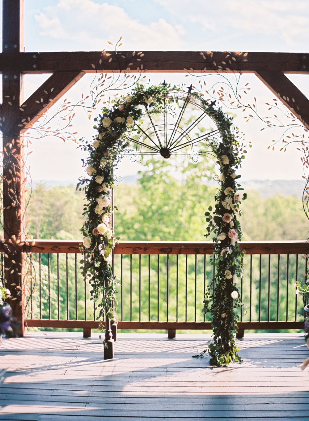 Inspired by fragrant eucalyptus, peonies, quicksand roses, white stock, and accents of spirea filled the garden-style arbor for the outdoor reception at Wolf Mountain Vineyards.   Cottrell Photography  |  Wolf Mountain Vineyards