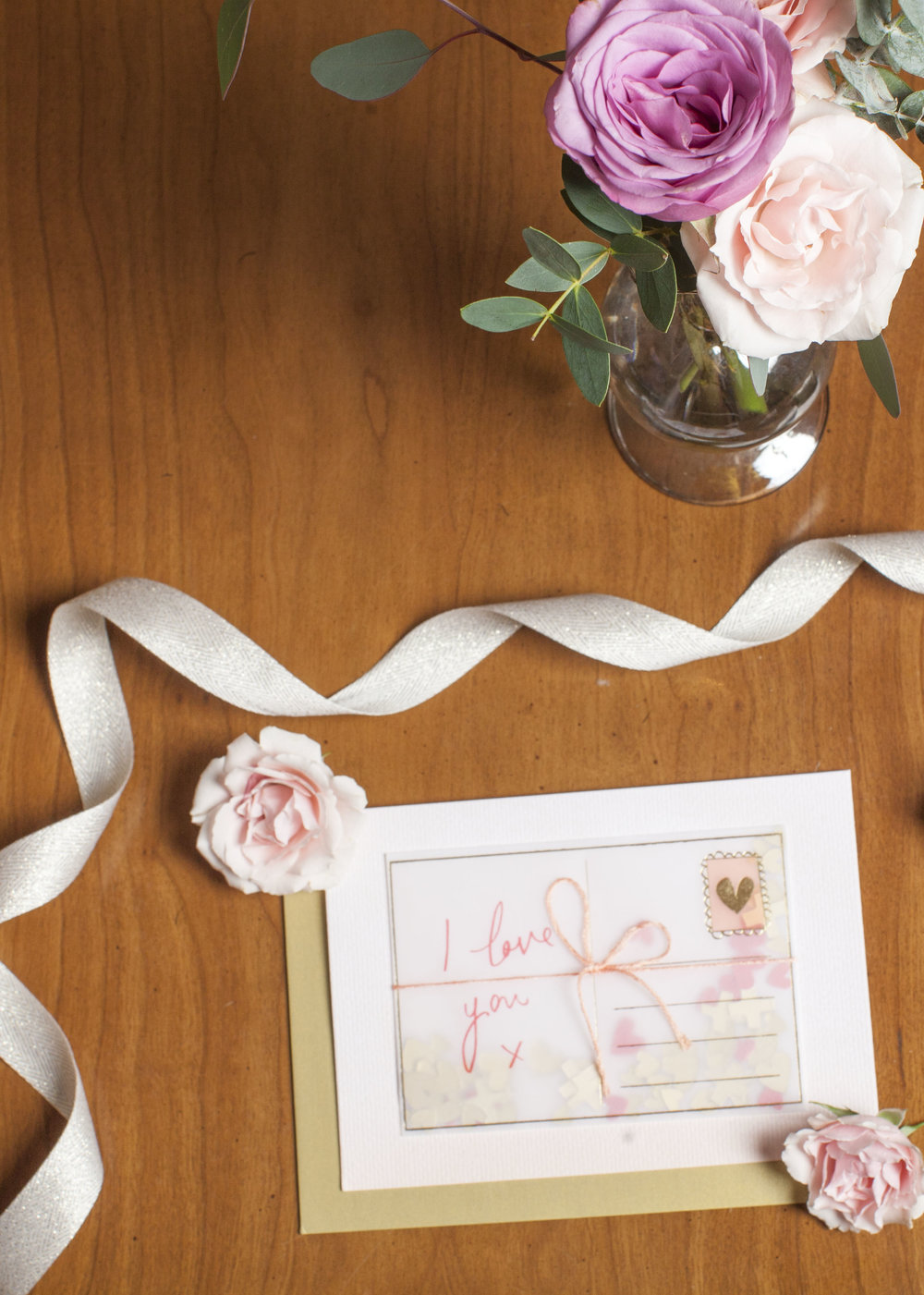 A bud vase and I love you card is a simple way to decorate a night stand or desk.