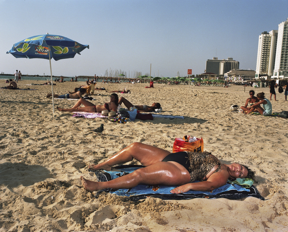 Woman in Leopard Suit Sunbathes, 2011