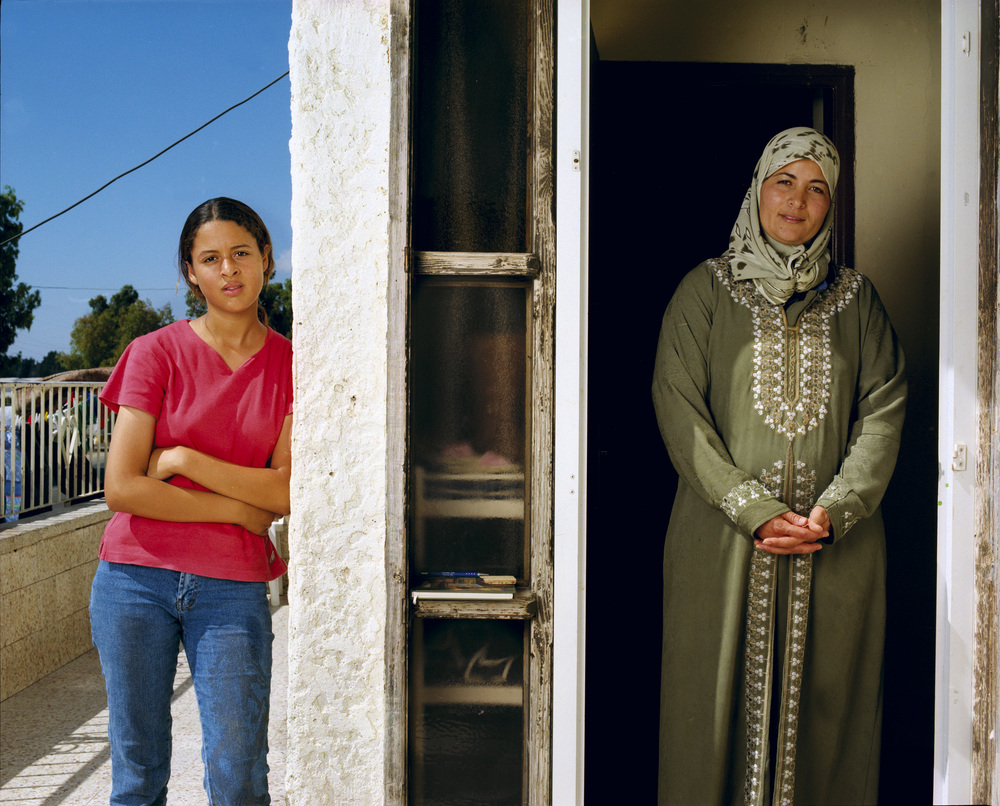 Masadi with her daughter  Fureidis, July 2002  I am thirty-five years old and the mother of six — five daughters [Hannan, one of the five, is standing to the left] and one son. I've worked for many years in Zichron Yaakov, the neighboring Jewish town, for the same family. They have become like family to me. We attend each other's gatherings and celebrations — birthdays, weddings, funerals. Some people in my village think I shouldn't be working for a Jewish family. Although we live in Israel and are happy to be citizens, some think we should stay loyal to our Palestinian brothers and not be friendly with the Jews. I tell them: to hate is easy. To love is hard. You have to be strong to love.