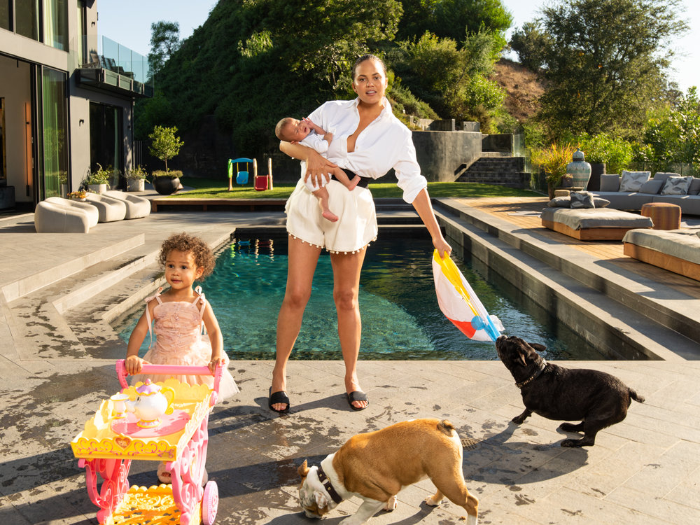Chrissy Teigen with her son Miles, daughter Luna, and dogs Penny and Paul / Vogue Magazine