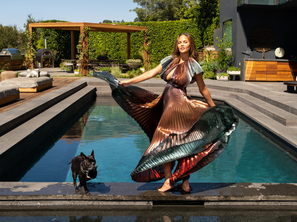 Chrissy Teigen with her dog Penny / Vogue Magazine