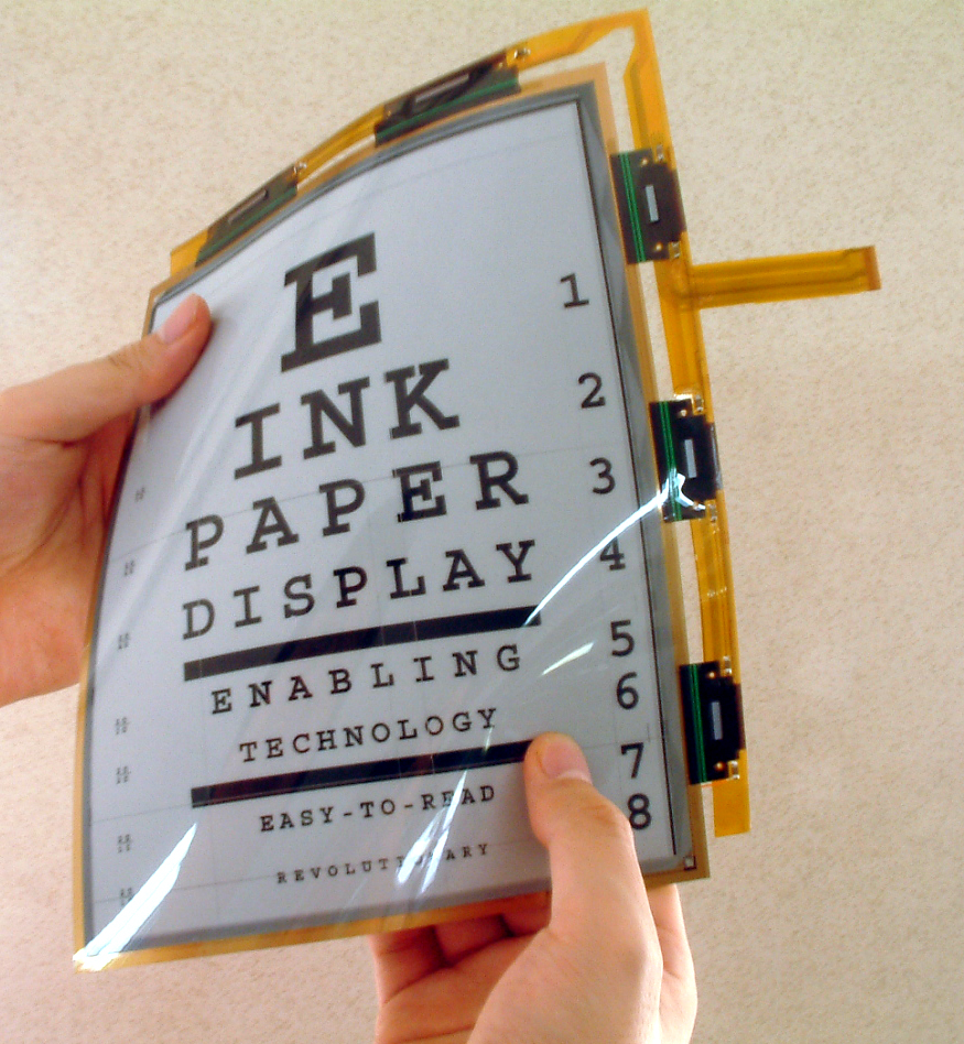 A flexible e-ink screen displays the shipping label