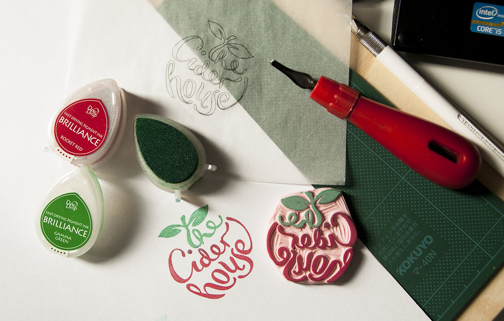 The logo is handmade in the form of a rubber stamp.