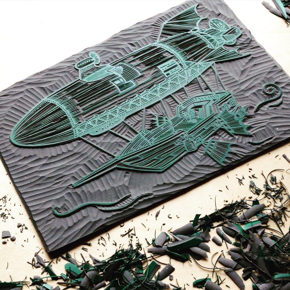 Each illustration is a handmade linocut.