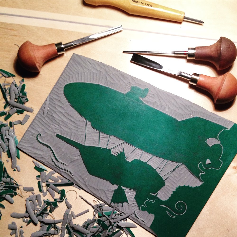 Each illustration is a handmade linocut.
