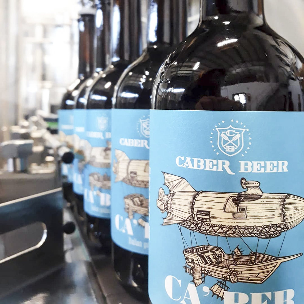 Craft beer being bottled and labeled.