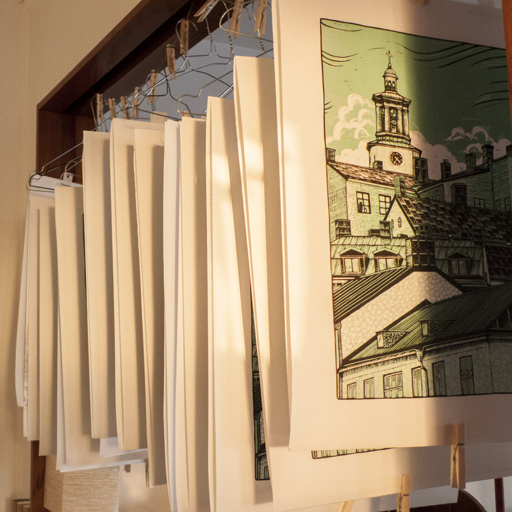 Print in light green hanging to dry.