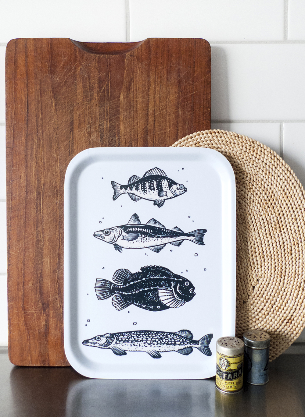 Birch serving trays printed with Tian's linocut designs.