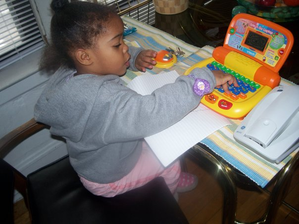 "My daughter age 3 ""running her business"" at my mother's kitchen table."