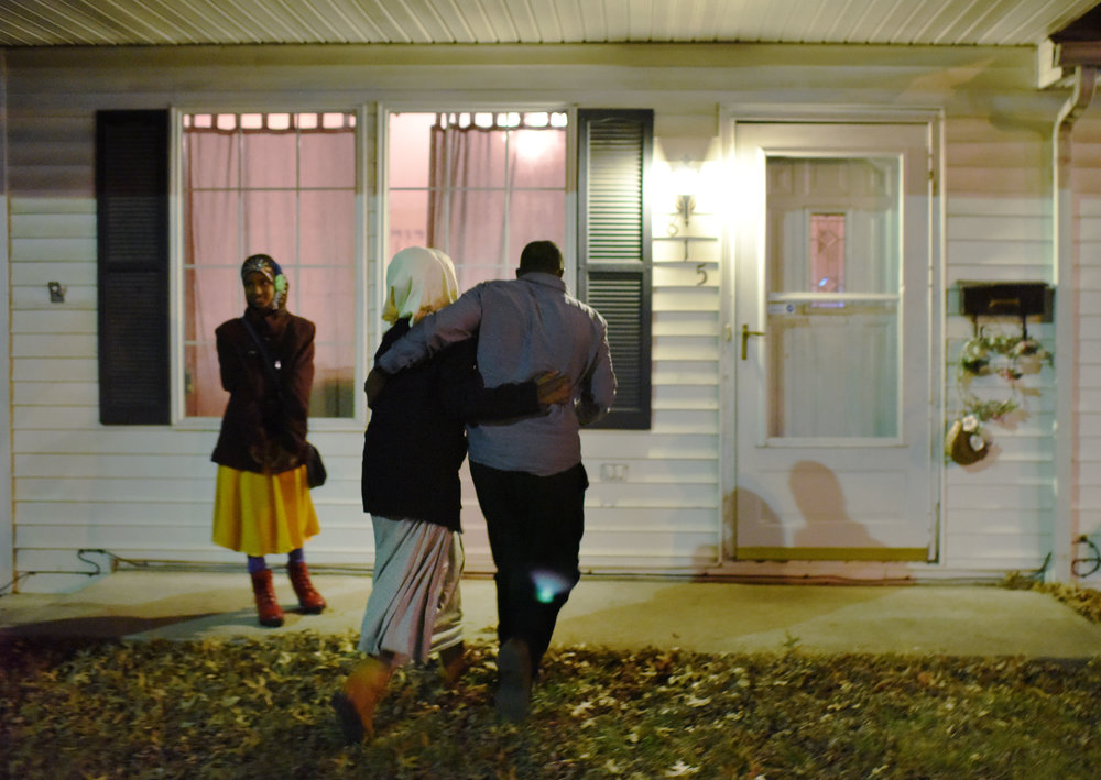 From left, Aniso Abdirahman, 12, Iqro Abdirahman, 13, and Abshir Abdirahman walk into their home after the family arrived in Columbia on Friday, Feb. 17, 2017. Abshir works two jobs to support his family.