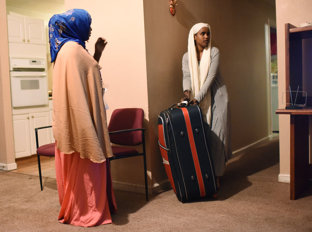 "Kahd Hassan Barre and her daughter Iqro Abdirahman(cq) get settled into their new home on Friday, Feb. 17, 2017. Kahd came with five of her six children. The sixth child, Yasin Abdirahman, 16,  had complications in the traveling process and was left in Africa. ""I will not be happy until I see my son,"" Barre said."