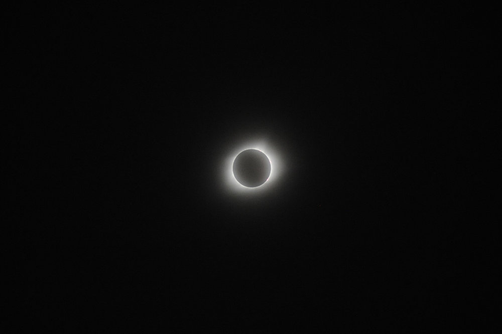 "The moon is perfectly aligned with the sun as totality of the eclipse is reached at Oak Spirit Sanctuary in Wooldridge, Missouri on Monday, August 21, 2017. The clouds parted a few minutes before totality, allowing the spectacle to be viewed, and then clouds covered the sun directly after. ""If that wasn't magic, I don't know what is,"" said pagan Samantha Walker of Hannibal, Missouri."