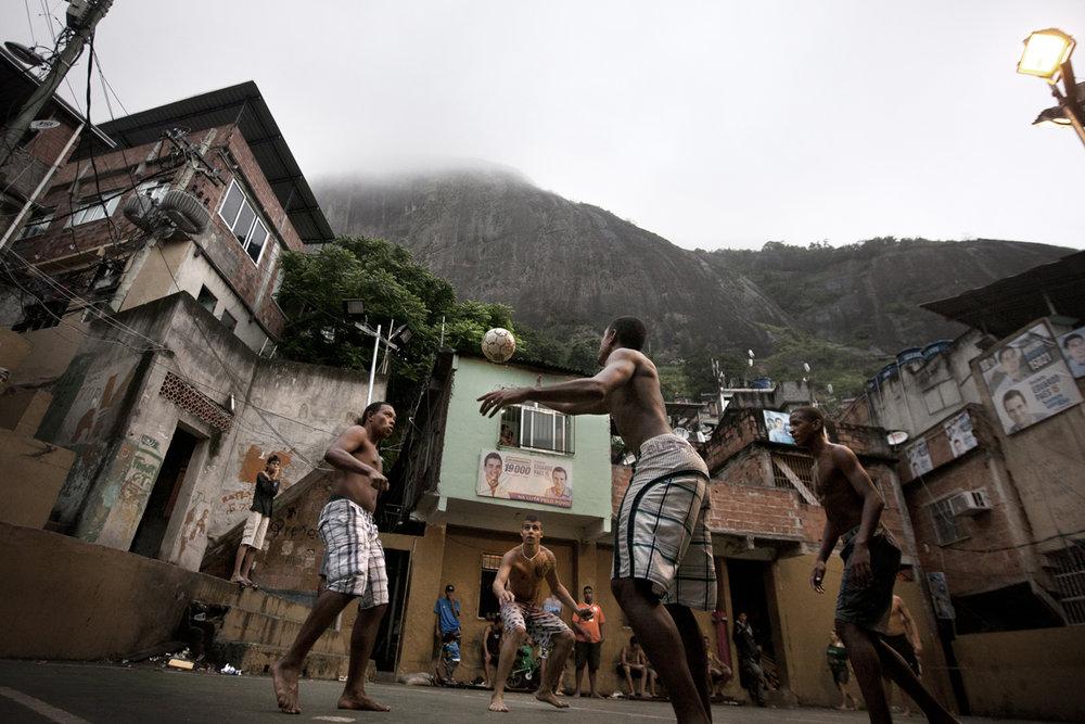 Teenagers play football in Rocinha, Rio's largest favela. Photo by Rafael Fabrés