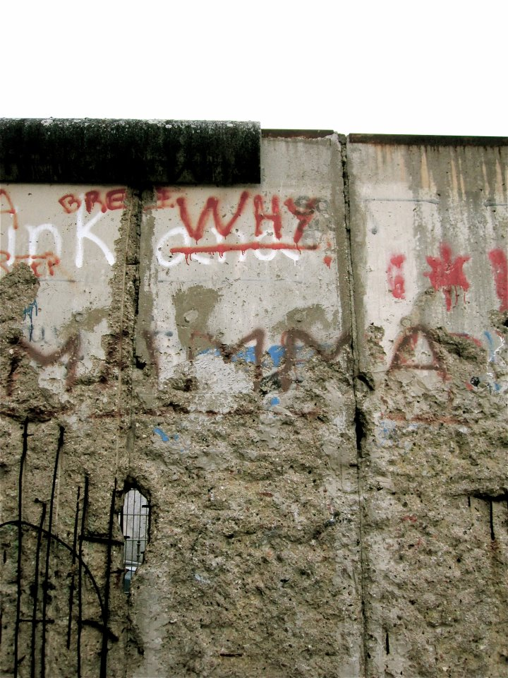 A photo of a section of the Berlin Wall at the Topography of Terror exhibit, with a poignant bit of graffiti.