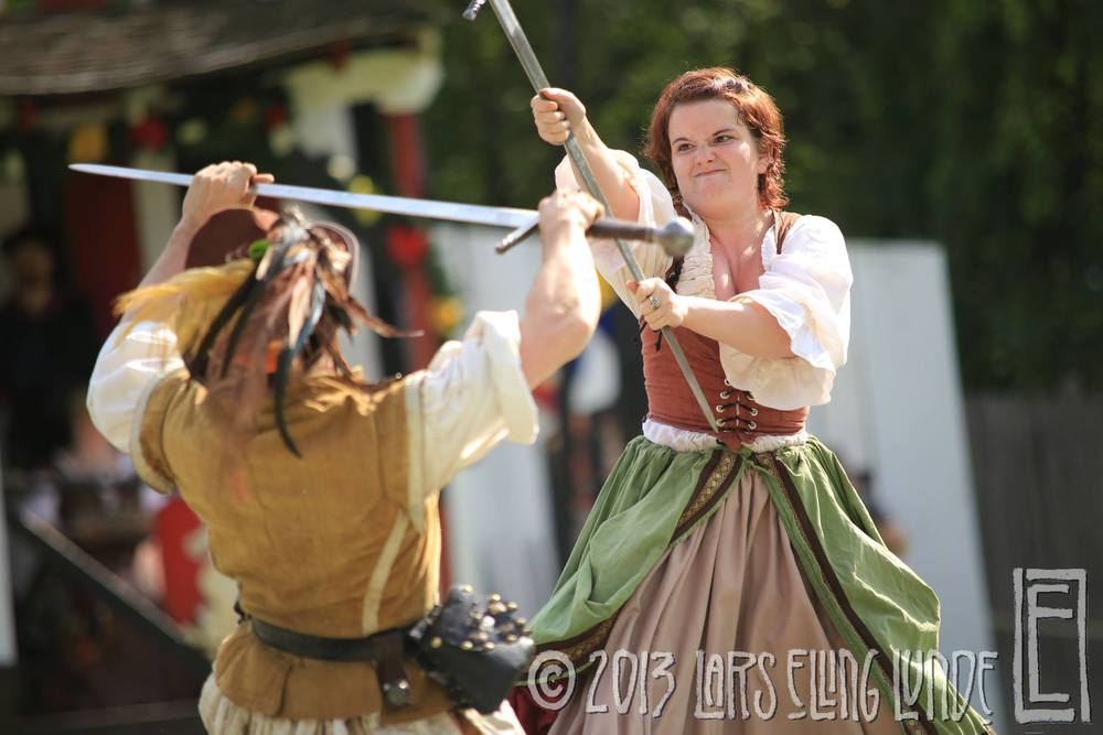 NYRF 2013, opening weekend - this fight was choreographed only two weeks beforehand and on my first day at the faire I performed it in front of hundreds of people (this was how I became known for broadsword fights - in three skirts, no less).