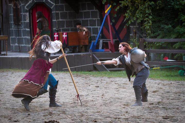 NYRF 2015, opening weekend - a fight with my favorite pirate during the melee on the joust field, and an interesting pairing of sword & buckler vs. trident (very nautical).