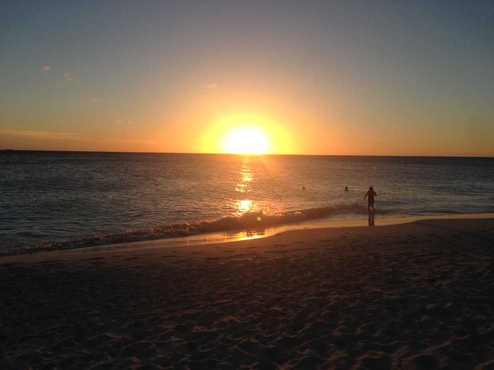 Sunset in Aruba, shutting the book on another day and another chapter.
