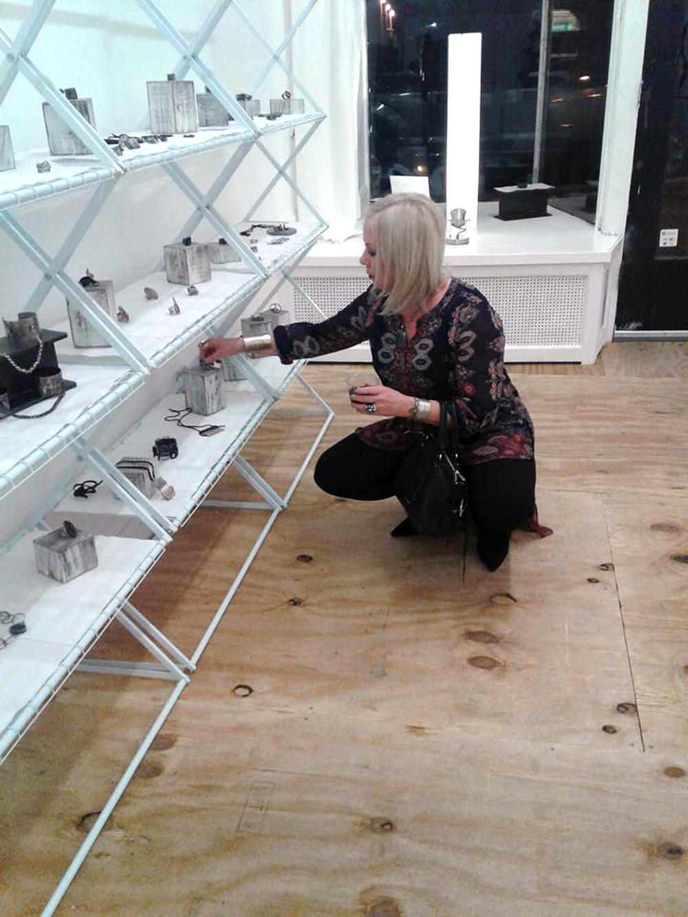 Adjusting jewelry at Gallery OVO.jpg