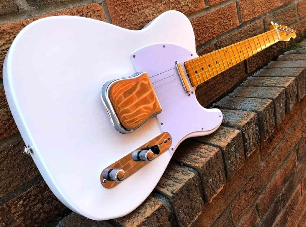 Black 35 ivory guitar.jpg
