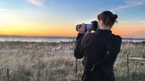 photographer taking picture at sunset - Seattle family photographers