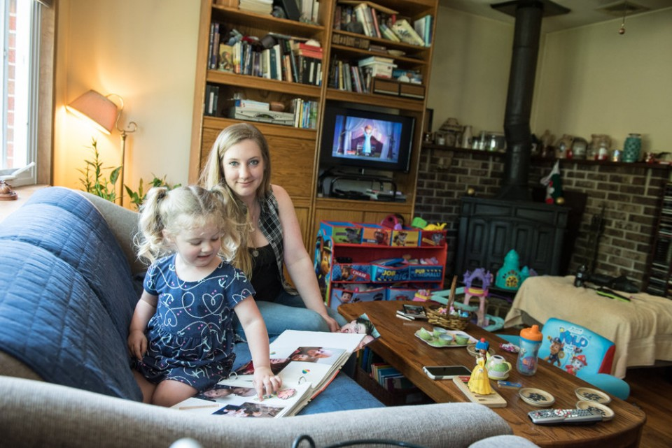 Judi Hundemann's fiancee, Michael Burke an Afghanistan combat veteran, committed suicide in October of 2015. Here, Judi and their daughter Arya Burke, 3, look at photos that include Michael. / Russ DeSantis | For NJ Advance Media