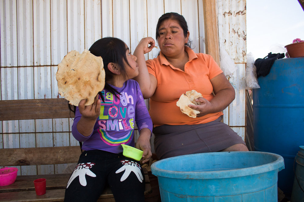 Lucero Vargas, left, 6, eats a tortilla with her mother, Herminia Vargas, 32, at their home in Zaachila, Mexico on Thursday, Jan. 12, 2017.