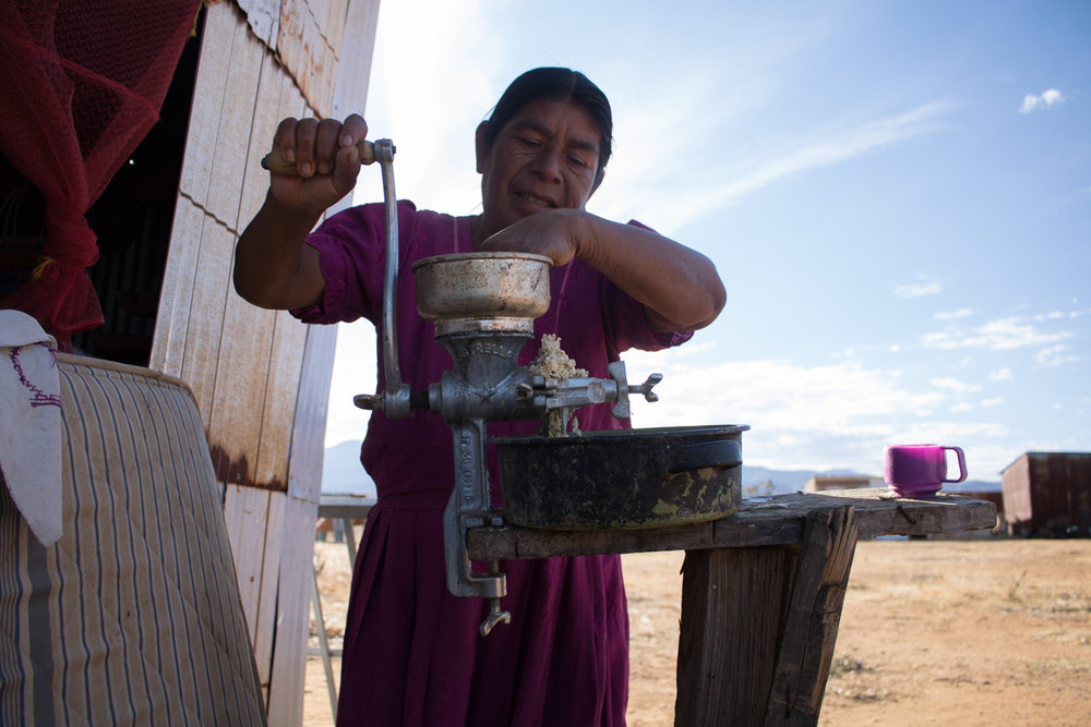 Auria Vargas, 63, grinds corn to feed the family's chickens in Zaachila, Mexico on Friday, Jan. 13, 2017.