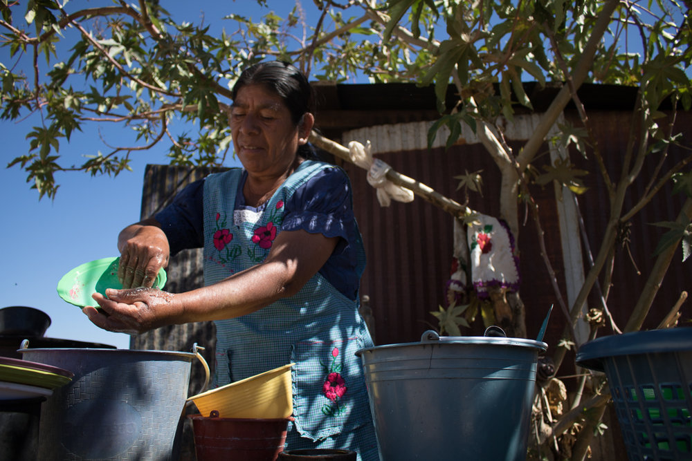 Auria Vargas, 63, cleans dishes outside of her home in Zaachila, Mexico on Thursday, Jan. 12, 2017.