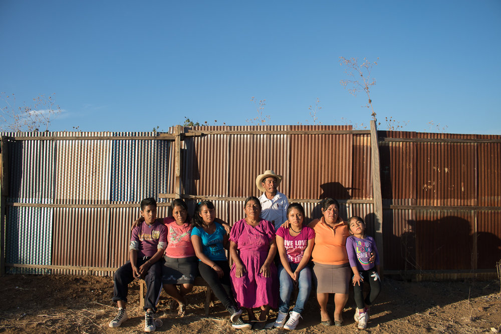 The Vargas family poses outside of their family homes in Zaachila, Mexico on Thursday, Jan. 12, 2017.