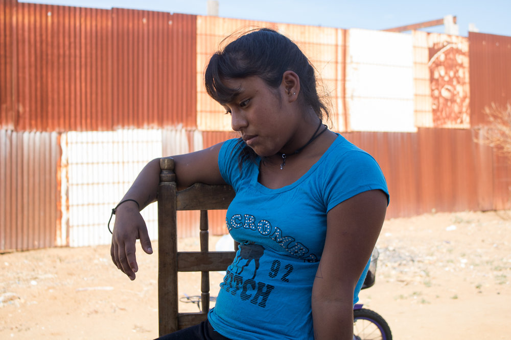 Yanitza Vargas, 13, sits outside of her family's home after school in Zaachila, Mexico on Friday, Jan. 13, 2017.