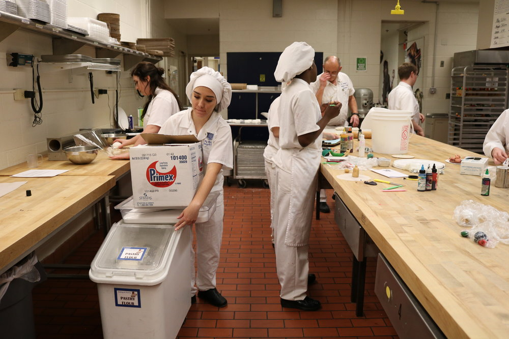 Ally Berrich, 17, gathers supplies to stay after her baking and pastry class at the Center of Applied Technology North in Severn, Md., on May 11, 2016.