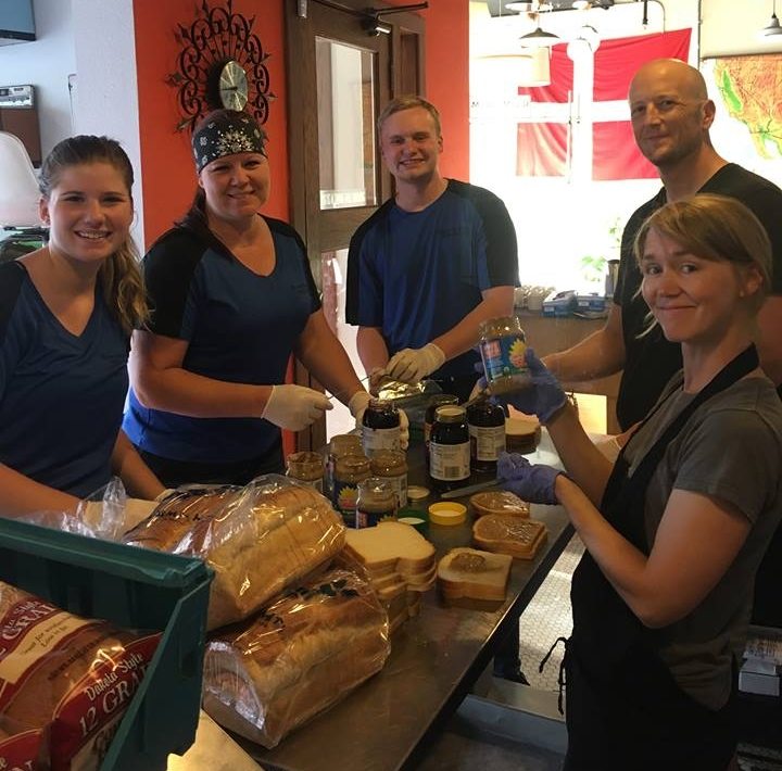 Volunteers prepare sandwiches for the inaugural fundraising event last year.