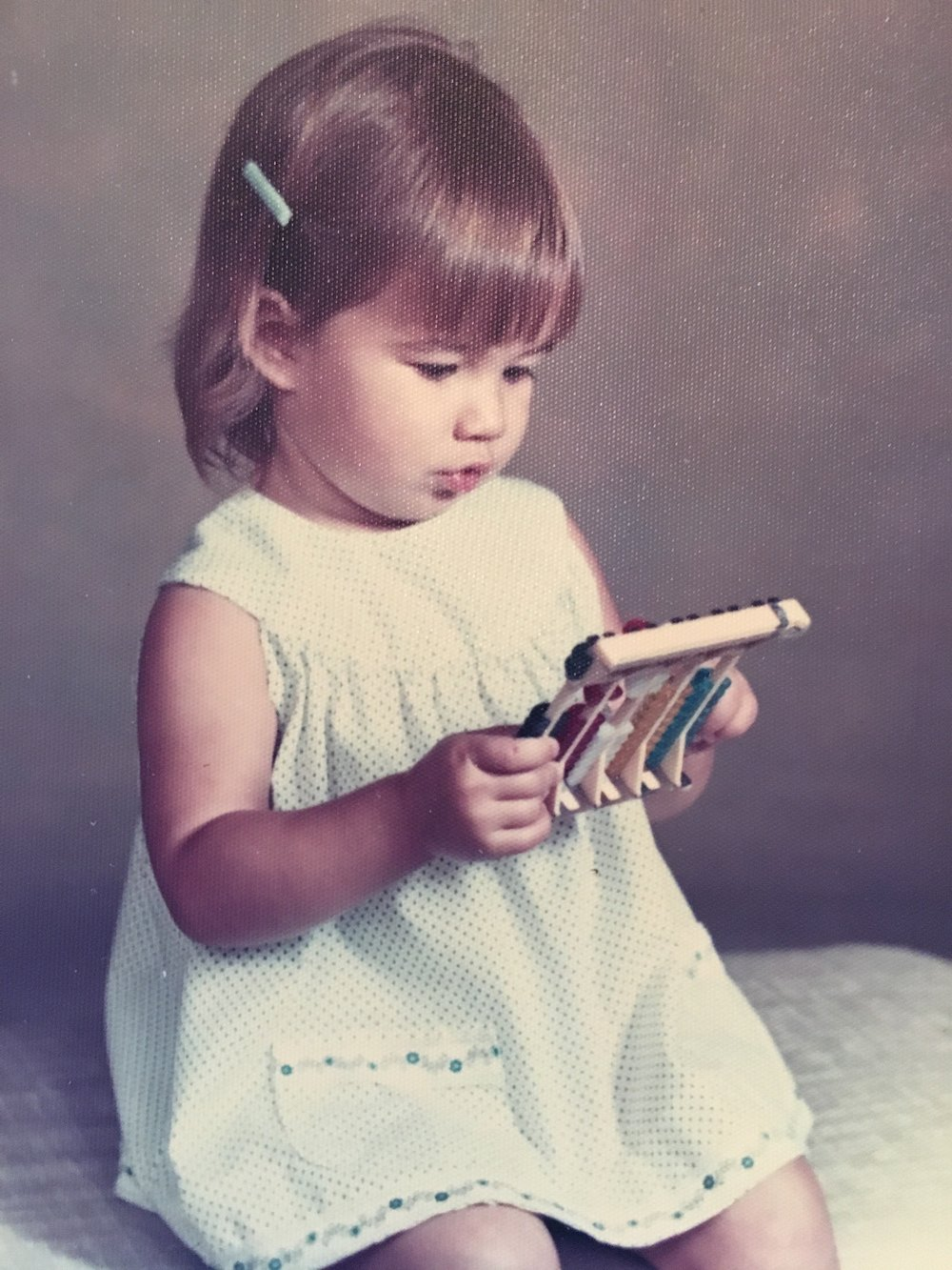 Early pic illustrating that math has never been one of my strong points. Who gives a kid an abacus as a prop anyway?