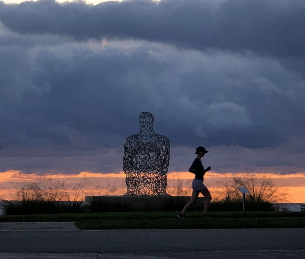 The runner pictured isn't me, but this pic is why running in the a.m. can be pretty awesome.