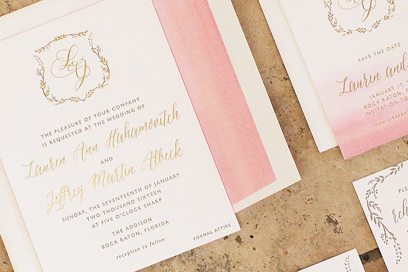 blush watercolor and gold foil invitations for a wedding at the