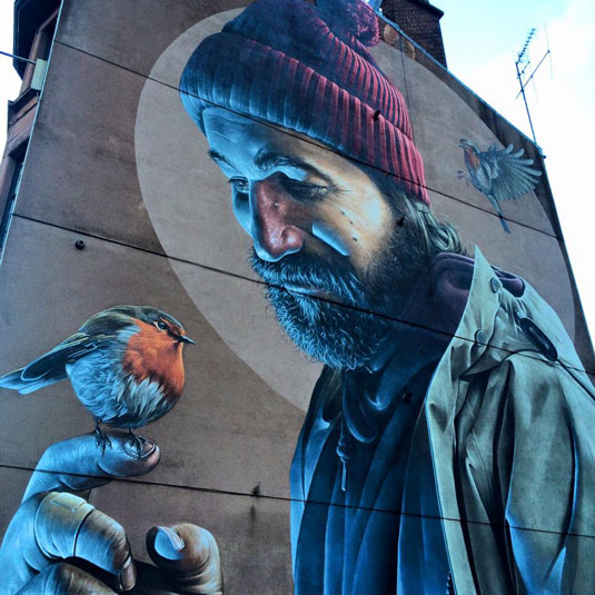 Smug specializes in photo-realistic graffiti; the Scottish city Glasgow funds a mural initiative.