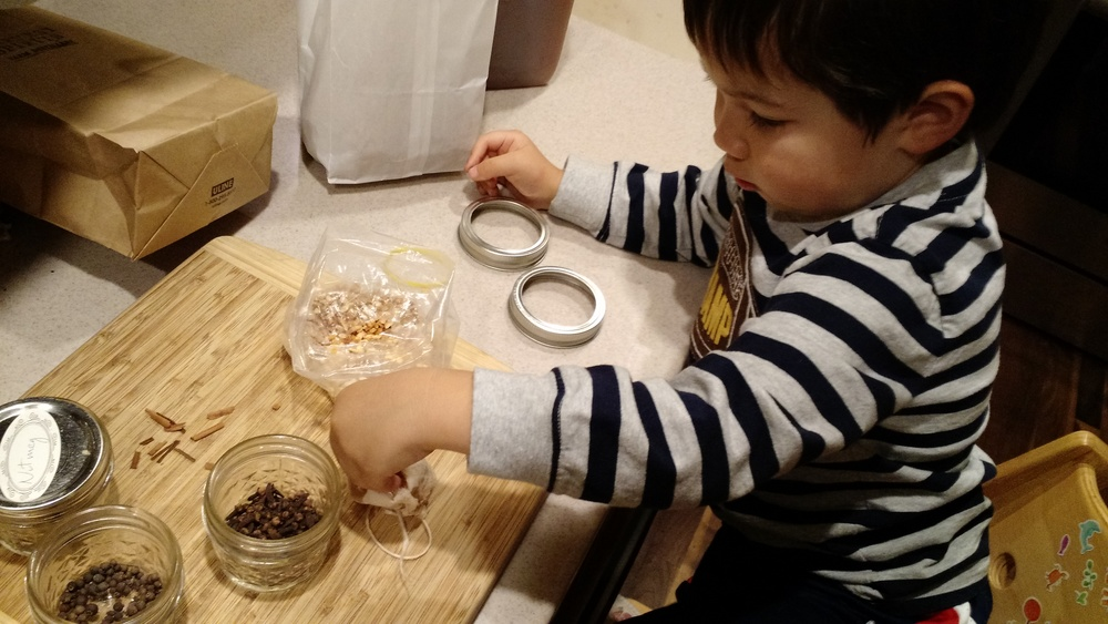adding spices to mulled cider
