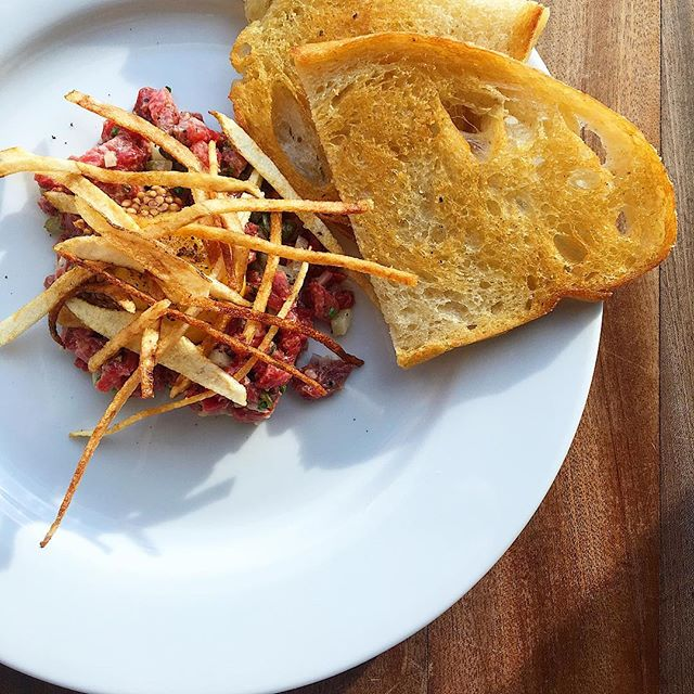beef tartare, shoestrings, duck fat toast . . . #asheville #food #avleats #foodphotography #riverartsdistrict #eat #eats #eater #lefooding #foodporn #tartare #beef #duckfat #frenchfood #eatstagram