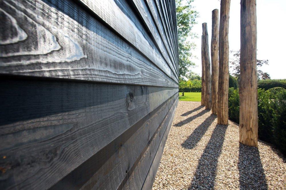 siebers-tuinprojecten-split-eiken-palen-gepotdekseld.jpg