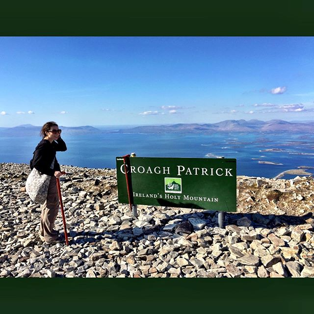 Happy Saint Patrick's Day! This throwback pic is from a pilgrimage to Croagh Patrick - Ireland's Holiest Mountain! 🍀🏔 . . In 441 AD St. Patrick fasted here for 40 days. Kudos St. Patrick— the trek wasn't exactly a walk in the park! ☘️ A walking stick is a must for the tiny rubble terrain. . Atop the mountain are beautiful views of Ireland — if you're lucky 🍀 you'll get a clear day! 🙂 . . #aroundtheworldinKatieDays #hiking #trek #outdoorlife #croaghpatrick #countymayo #pilgrimage #hiking #hiking👣 #irelandtravel #irelandpilgrimage #croaghpatrickmountain #saintpatrick