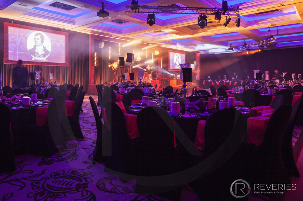 Burns Night Supper - The room with table design and AV set up