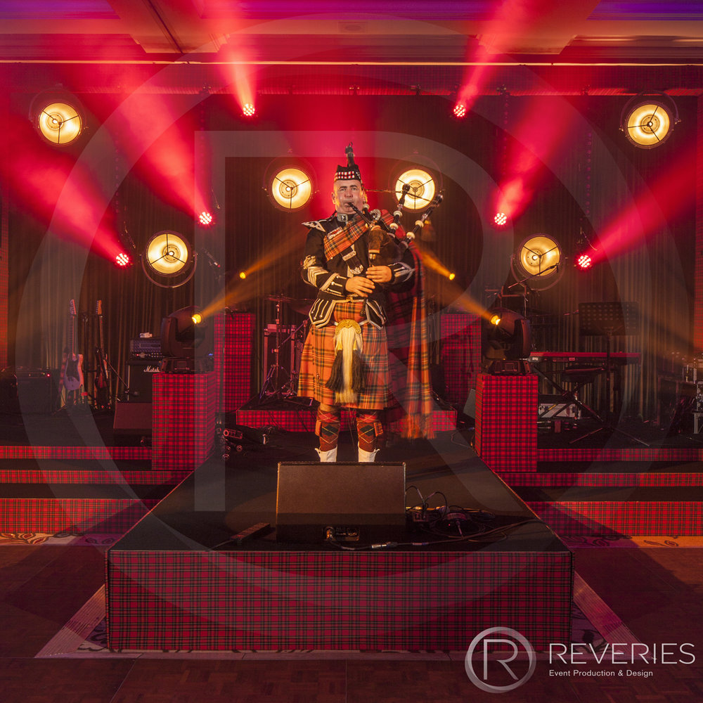 Burns Night Supper - Bagpipe player on our custom tartan stage