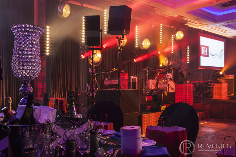Burns Night Supper - Table and bespoke tartan stage detail